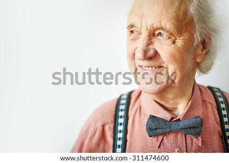 Senior well-dressed man looking aside - stock photo