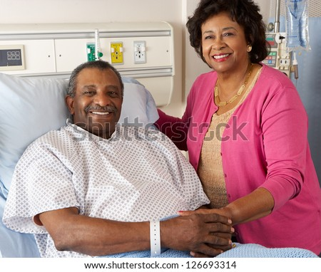 Senior Wife Visiting Husband On Ward - stock photo