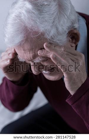 Senior with chronic headache - stock photo