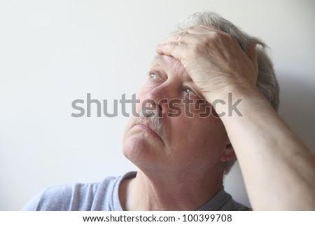 senior with head pain - stock photo