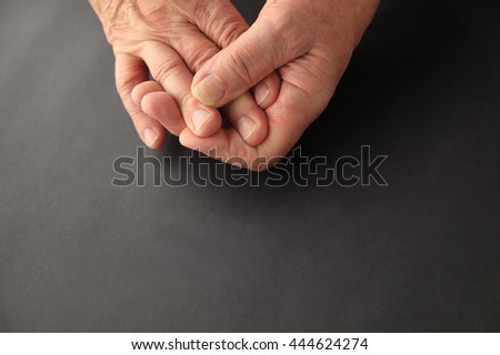 Senior with sore finger, copy space included - stock photo