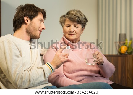 Senior woman and caring grandson at home