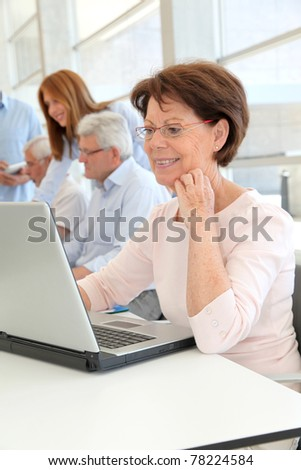 Senior woman attending business training - stock photo