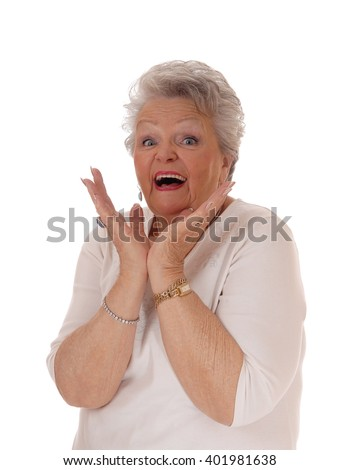 Senior woman beaming from exited with her mouth open and hands
