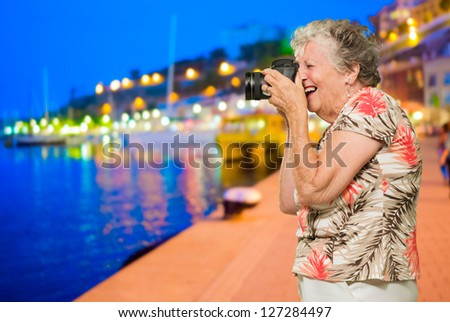 Senior Woman Clicking Photo, Outdoors