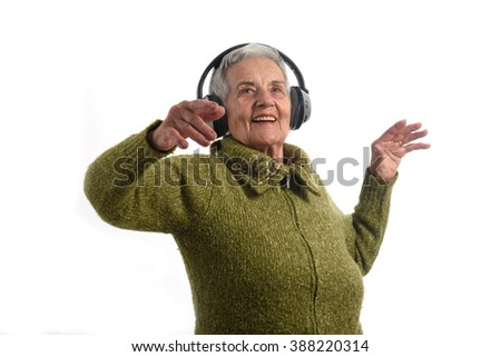 Senior woman dancing with white background - stock photo
