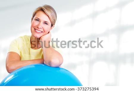 Senior woman doing yoga. - stock photo