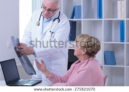 Senior woman during medical visit in doctor's office - stock photo