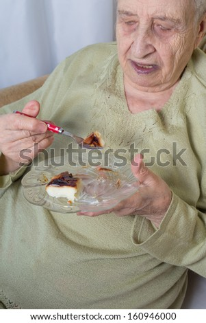 senior woman eating dessert