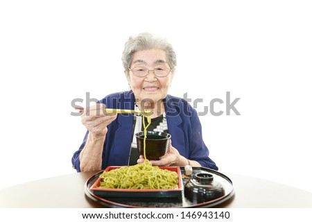 Senior woman eating meal