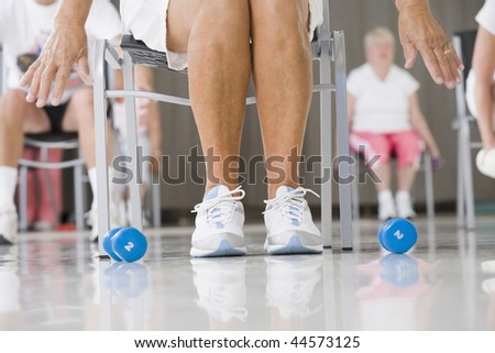 Senior woman exercising in a gym