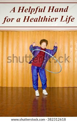 Senior woman exercising with a hula hoop - stock photo