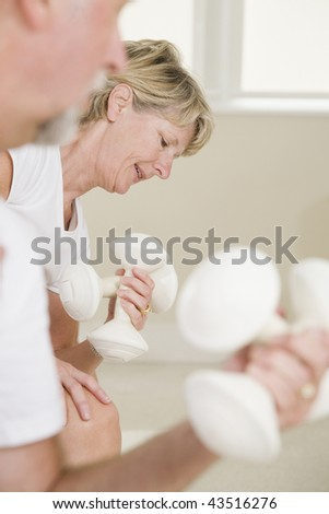 Senior woman exercising with hand weights - stock photo