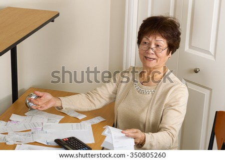 Senior woman expressing frustration with her financial bills. In debt concept.  - stock photo