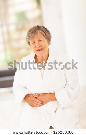 senior woman feeling sick at home - stock photo