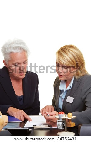 Senior woman getting financial advice from investment adviser - stock photo