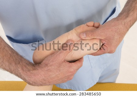 Senior woman having a Foot massage - stock photo