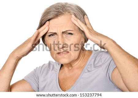 Senior woman having headache. Isolated on white