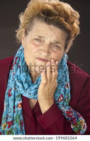 Senior woman having tooth ache. Portrait - stock photo