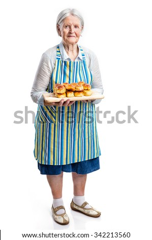 Senior woman holding fresh buns over white - stock photo