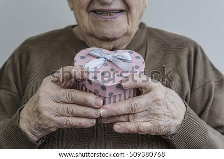 senior woman holding gift
