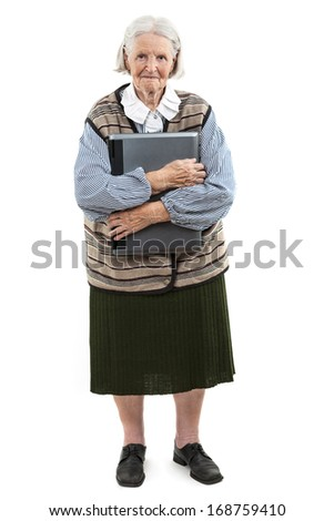 Senior woman holding laptop computer isolated on white - stock photo