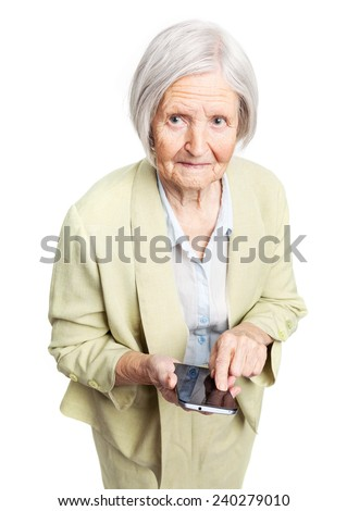 Senior woman holding mobile phone and looking at camera over white