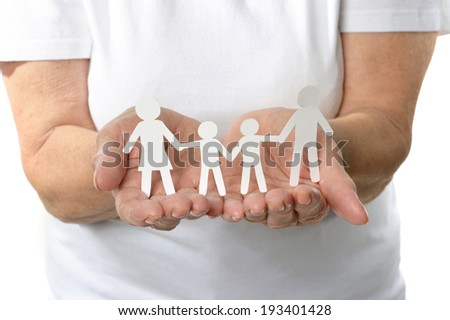 Senior woman holding paper family Older woman applying cream on hands closeup on a white background - stock photo
