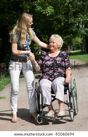 Senior woman in a wheelchair and her granddaugther