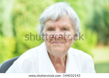 Senior woman in garden. MANY OTHER PHOTOS WITH THIS MODEL IN MY PORTFOLIO.
