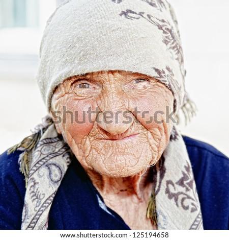 Senior woman in shawl closeup portrait - stock photo