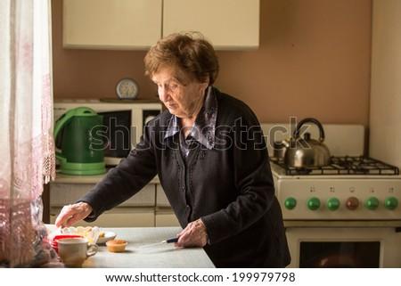 Senior woman in the kitchen. - stock photo