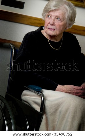 senior woman in wheelchair - stock photo