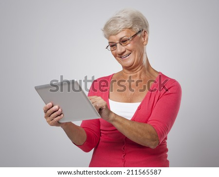 Senior woman is keeping abreast with new technology