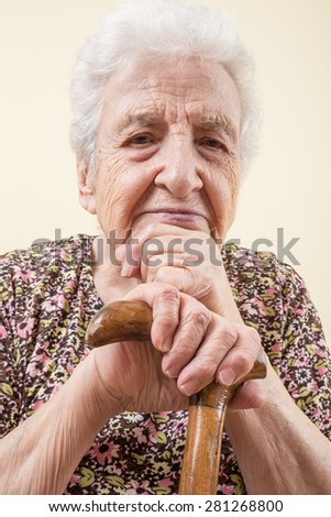 senior woman leaning on cane - stock photo