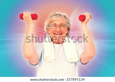 Senior woman lifting hand weights against abstract background - stock photo
