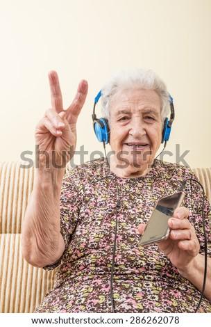 senior woman listening music - stock photo