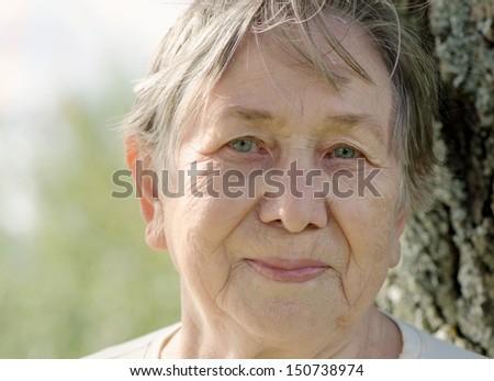 Senior woman outdoors  in summer. Selective focus - stock photo