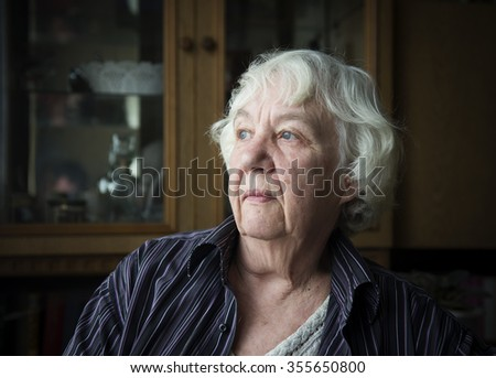 Senior woman pensive and worried - stock photo