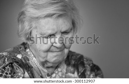 Senior woman pensive and worried. Black and white.