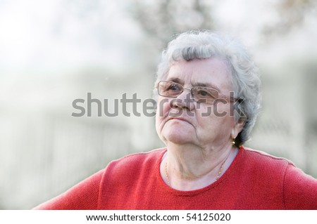 Senior woman portrait on black and white background