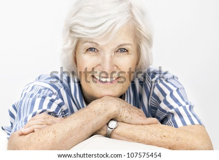 Senior woman portrait, on white background with white hair ,smiling happy to camera - stock photo