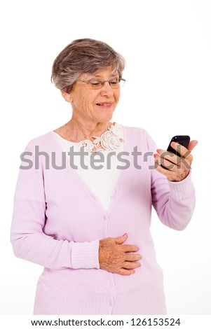 senior woman reading message on smart phone isolated on white - stock photo