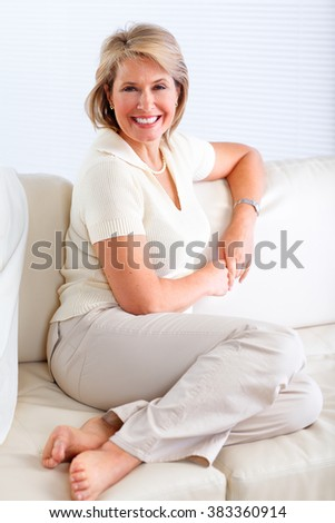 Senior woman relaxing in modern apartment.