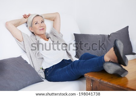 Senior woman relaxing on her sofa.