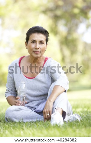 Senior Woman Resting After Exercise - stock photo