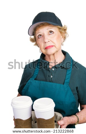Senior woman serving coffee because she can't afford retirement. Isolated on white.   - stock photo