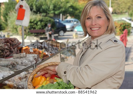 senior woman shopping at the market - stock photo