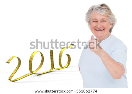 Senior woman showing thumbs up against white background with vignette - stock photo