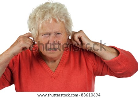 senior woman shut her ears on white background